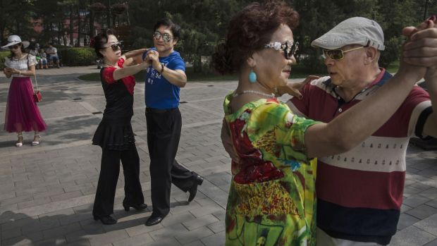 Chinese couples dance in Ritan Park – a popular spot for elderly citizens – in Beijing, China. By 2030 one quarter of China's population is expected to be aged 60 or older. Photograph: Kevin Frayer/Getty Images