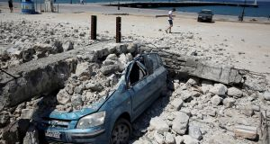 A car under  debris  after an earthquake off the island of Kos, Greece, in July  2017. Photograph: Reuters/Costas Baltas