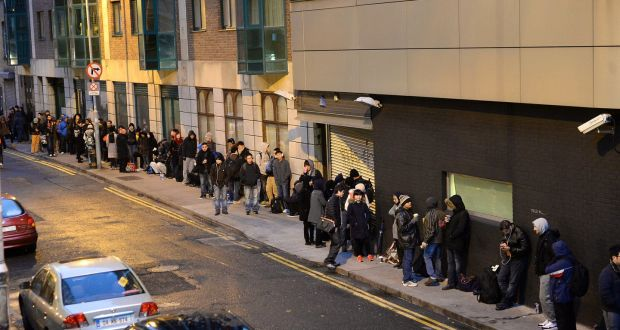 People waiting for the Garda National Immigration Bureau to open on Burgh Quay, Dublin in 2014. Photograph: Cyril Byrne / THE IRISH TIMES