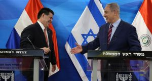 Israeli leader Binyamin Netanyahu reaches out to shake hands with Paraguay's then leader Horacio Cartes at a 2016 meeting in Jerusalem. File photograph: Gali Tibbon/AFP/Getty Images