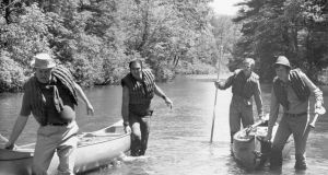 American actors Ned Beatty, Burt Reynolds, Jon Voight and Ronny Cox pull their canoes through the shallows of a river in a still from director John Boorman's film 'Deliverance'. Photograph: Warner Bros./Getty Images
