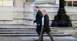 Investigative journalists Trevor Birney (left) and Barry McCaffrey arriving at the High Court in Belfast  on Friday. Photograph:  Liam McBurney/PA