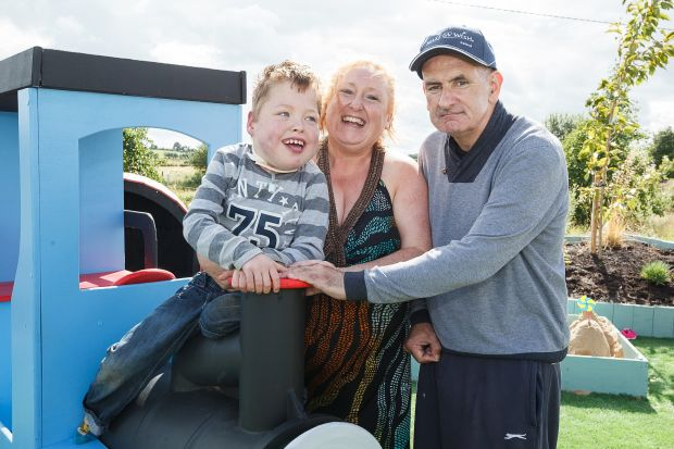 Liam Mac an Tsaoi (7) from Clonberne, Co Galway with his Mum Louise and Dad Sean.