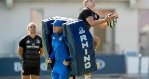 Leinster backs coach Felipe Contepomi with Jordan Larmour practising his catching. Photograph: Morgan Treacy/Inpho