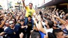 Presidential candidate Jair Bolsonaro carried on the shoulders of a supporter moments before being stabbed during a campaign rally in Juiz de Fora, Brazil on Thursday. Photograph: Antonio Scorza/Agencia O Globo via AP
