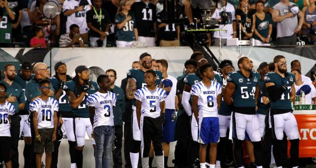 Members of the Philadelphia Eagles stand for the national anthem before  they re NFL meeting 2ce23e2ba