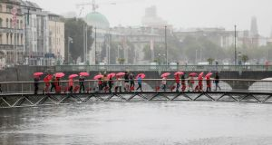 Ten older women pack red suitcases for Halfpenny Bridge 'Freedom March'. Photograph: Julian Behal