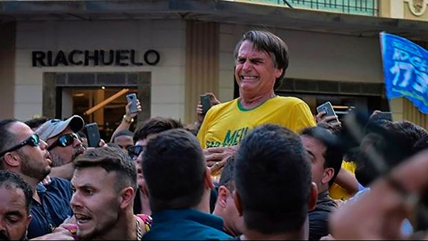 Knife attack: Jair Bolsonaro grimaces after being stabbed in the stomach on Thursday. Photograph: Raysa Leite/AFP