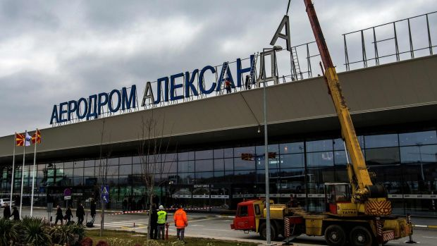 Workers remove the cyrillic letters spelling out the name of the airport named after Alexander the Great, on the outskirts of Skopje, Macedonia, in February. File photograph: Robert Atanasovski/AFP/Getty Images