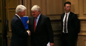 Former US president Bill Clinton and Irish businessman Denis O'Brien shake hands at the Concern Worldwide 50 years Tackling Extreme Poverty Conference in Dublin Castle on Friday. Photograph: Sasko Lazarov/Photocall Ireland