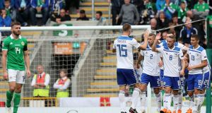 Bosnia and Herzegovina players celebrate scoring their second goal of the game as Northern Ireland's Stuart Dallas (left) looks on during the Uefa Nations League, League B Group Three match at Windsor Park, Belfast. Photo: Brian Lawless/PA Wire