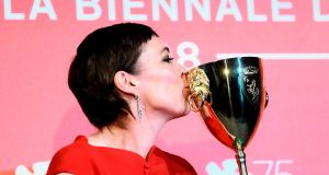 Actor Olivia Colman celebrates with the Coppa Volpi for Best Actress in 'The Favourite' at the Venice Film Festival. Photograph: Filippo Monteforte/AFP/Getty Images