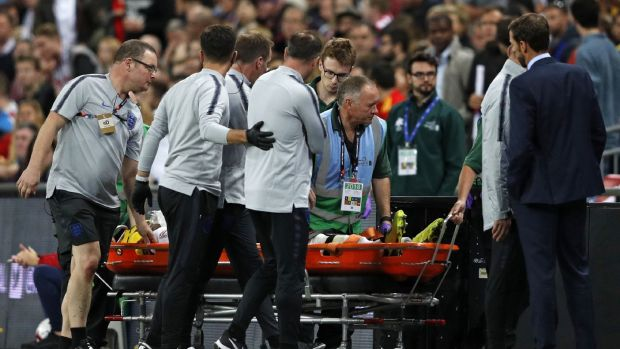 England's manager Gareth Southgate looks on as England's defender Luke Shaw is taken off on a stretcher. Photograph: Getty Images