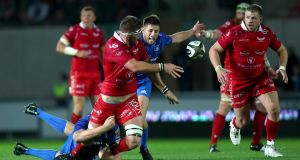 Scarlets' Steve Cummins gets an offload away against Leinster. Photograph: James Crombie/Inpho