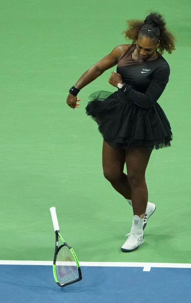 Williams smashes her racket during the match. Photo: Getty Images