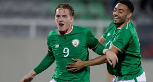 Ireland's Reece Grego-Cox celebrates with his teammate Ronan Curtis after he scored the equaliser against Kosovo in the under-21 European Championship qualifier. Photo: EPA
