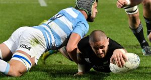 New Zealand's TJ Perenara  scoring a try despite the tackle of  Argentina's Guido Petti Pagadizaval  at Trafalgar Park in Nelson, New Zealand. Photograph: Getty Images