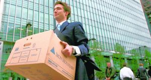 A worker  carrying a box out of  US investment bank Lehman Brothers offices, in  London in September  2008. Photograph:  Reuters/Andrew Winning