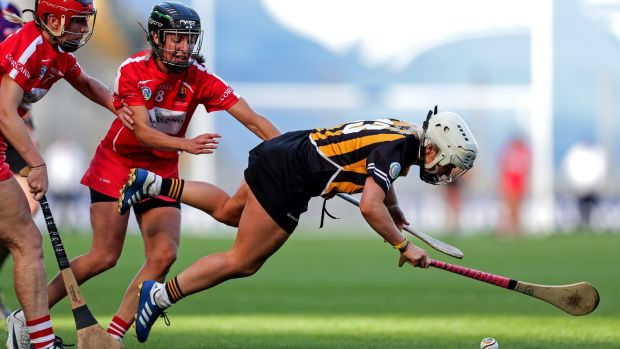 Kilkenny's Shelly Farrell is tackled by Julia White of Cork during the All-Ireland camogie final at Croke Park. Photo: Laszlo Geczo/Inpho