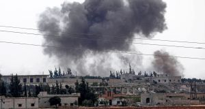 Smoke billows following Syrian  bombardment of Al Habit on the edges of rebel-held Idlib province,  September 9th, 2018. Photograph:  Omar Haj Kadour/Getty