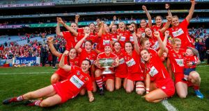 The Cork camogie team celebrate winning the All-Ireland title after beating Kilkenny. Photograph:   James Crombie/Inpho