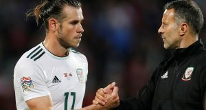 Wales' Gareth Bale shakes hands with manager Ryan Giggs after the match  against Denmark in Aarhus. Photograph: Reuters/Matthew Childs