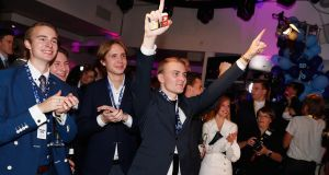 Young members and supporters of the far-right Sweden Democrats react to the results of the exit polls at their party election centre  in Stockholm. Photograph: Michael Campanella/Getty Images