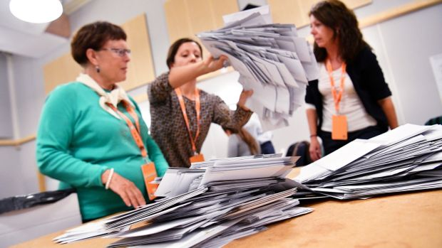 Electoral officials prepare to count ballots at a polling station in Malmo, Sweden, on Sunday. Photograph: Johan Nilsson/TT News Agency/via Reuters