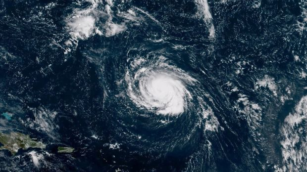 Hurricane Florence seen over the Atlantic Ocean, about 1,207km southeast of Bermuda. Photograph: NOAA NWS National Hurricane Center/Reuters