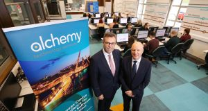 Invest NI chief executive Alastair Hamilton  with John Harkin, director and founder of Alchemy. Photograph: Kelvin Boyes/Press Eye