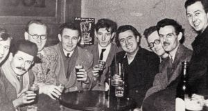 Four here at McDaid's inspired characters in The Ginger Man: Tony McInerney (Tony Malarkey, fourth from left), Brendan Behan (Barney Berry, sixth), Gainor Crist (Sebastian Dangerfield, seventh), Desmond MacNamara (MacDoon, right). Photograph: Courtesy JP Donleavy archive