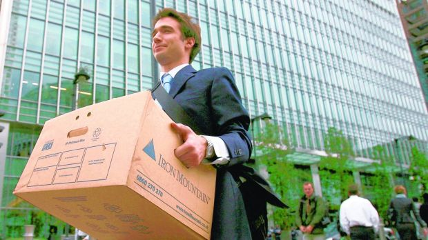 A Lehman employee in London leaves the office.