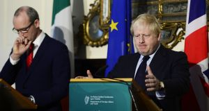 A file image of Tánaiste Simon Coveney with Boris Johnson (right) at Iveagh House in Dublin earlier this year. Photograph: Cyril Byrne/The Irish Times.