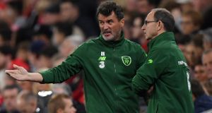 Ireland assistant manager, Roy Keane, speaks with Martin O'Neill during the Nations League defeat to Wales. Photo: Stu Forster/Getty Images