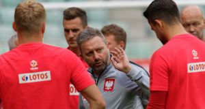 Polish head coach Jerzy Brzeczek  talks to his players at a  training session in Wroclaw, Poland before the international friendly against the Republic of Ireland.  Photograph: Jan Karwowski/EPA