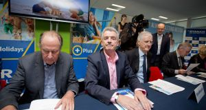 Ryanair chief executive Michael O'Leary  with chairman David Bonderman (left) and non-executive director Kryan McLaughlin at Ryanair's  agm in Dublin in 2017.  Photograph: Tom Honan