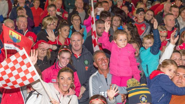 Fans turn out to welcome their camogie heroes on their arrival at the South Mall in Cork city. Photograph: Michael MacSweeeney/Provision