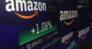 The Amazon logo and stock price information   at the Nasdaq market site in New York on  September 4th, the day Amazon  became a trillion dollar company. Photograph:   Reuters