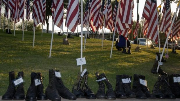 'The Healing Field 9/11 memorial in Tempe, Arizona is heartbreakingly beautiful, each one of its 2,996 flags signifying a life taken on that horrific autumn morning... On the grass, for veterans lost that day, pair after pair of combat boots.'