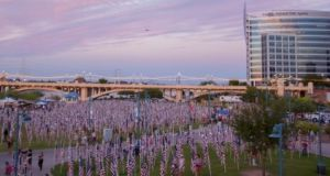 'In this field of healing, flanked by row upon row of flagpoles set five feet apart, we can stretch out our arms and touch two lives at a time, lest we forget what happened on September 11th, 2001.'