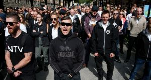 Supporters of the neo-Nazi Nordic Resistance Movement in Kungsholmstorg square, Stockholm, in August: a third of links shared via Twitter with Swedish political hashtags were  sensationalist, conspiratorial or designed to mislead.  Photograph: Fredrik Persson/EPA