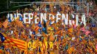 People wave pro-independence Catalan flags during a demonstration in Barcelona. Photograph: Lluis Gene/AFP/Getty Images