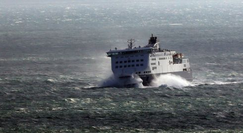 NOT FAR NOW: A DFDS ferry crashes through waves as it nears the Port of Dover on the southern English coast in windy conditions. Photograph: Gareth Fuller/PA Wire