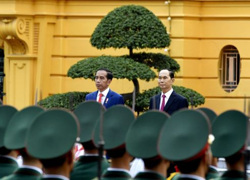 HANOI ROCKS: President of the Republic of Indonesia Joko Widodo (left) and President of Vietnam Tran Dai Quang review a Vietnamese People's Army honorary delegation in Hanoi, Vietnam. Photograph: Nhac Nguyen/Reuters