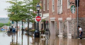 Water floods outside buildings in Old Town Alexandria, Virginia. Photograph: Zach Gibson/AFP/Getty Images