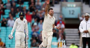 Jimmy Anderson celebrates taking the wicket of Mohamed Shami - his 564th victim in Test cricket. Photograph: Paul Childs/Reuters
