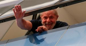 Brazilian former president Luiz Inacio Lula da Silva waves from a window of the Metallurgical Union, in Sao Bernardo do Campo, Sao Paulo state, last April. Photograph: Miguel Schincariol/AFP/Getty Images