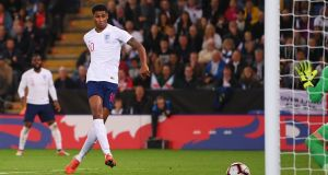 England's Marcus Rashford  scores his team's first goal during the international friendly against  Switzerland at The King Power Stadium  in Leicester. Photograph Laurence Griffiths/Getty Images