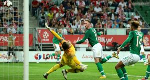 Aiden O'Brien  heads home to give the Republic of Ireland the lead in the friendly international against Poland   at the Stadion Miejski in Wroclaw. Photograph:   Steven Paston/PA Wire.