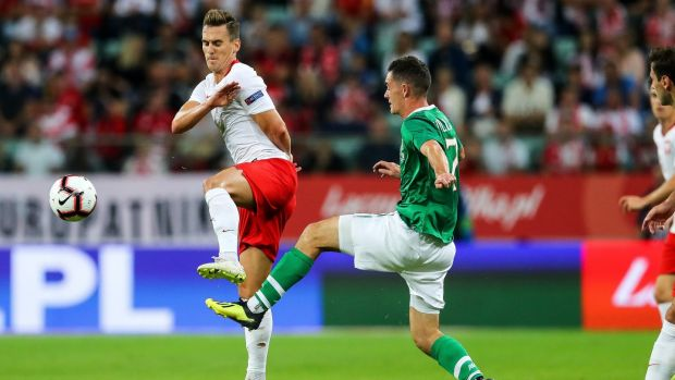 Republic of Ireland midfielder Shaun Williams challenges Arkadiusz Milik of Poland during the friendly international in Wroclaw. Photograph: Ryan Byrne/Inpho